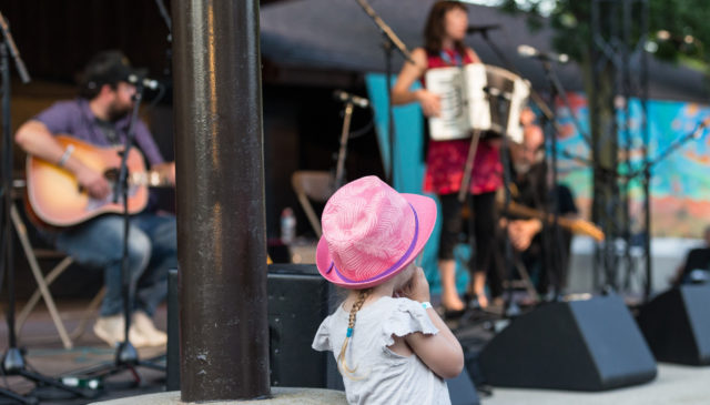 little girl pink hat by stage Summerfolk 2015 Saturday August 22 2015 image by ©kerry JARVIS-38